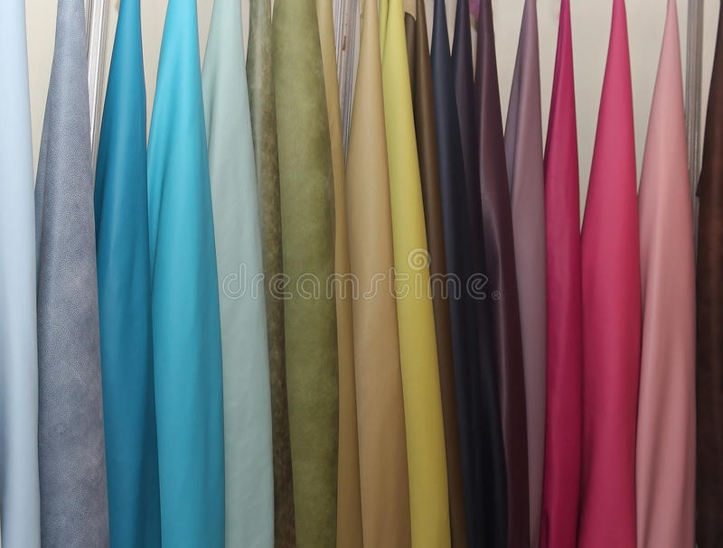 Leather materials samples. Colorful leather materials samples on show room wall stock images