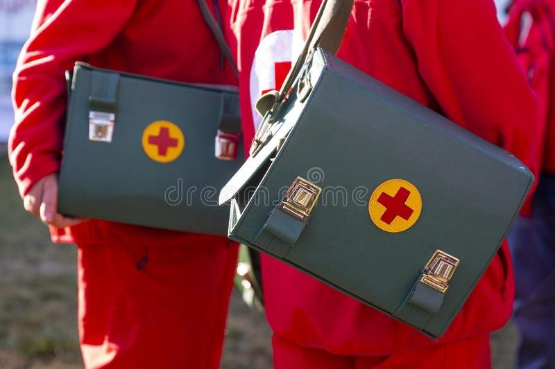 Leather medical bags with red crosses royalty free stock photos