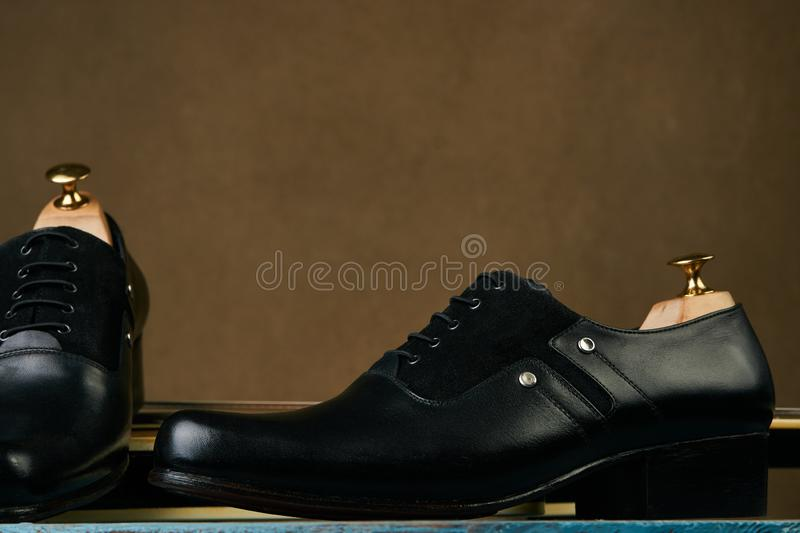 Leather mens shoes and bass guitar over brown background with copy space royalty free stock photo