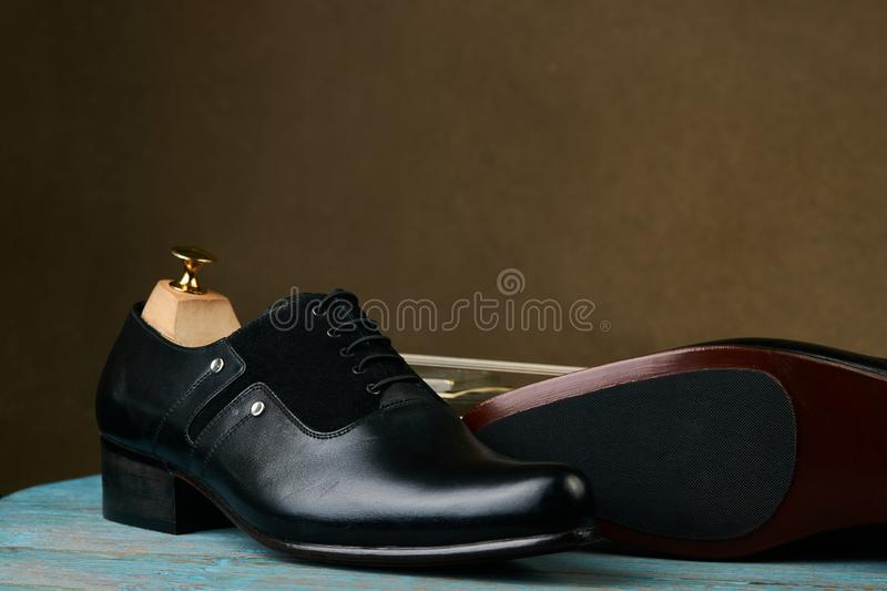 Leather mens shoes and bass guitar over brown background with copy space royalty free stock photos