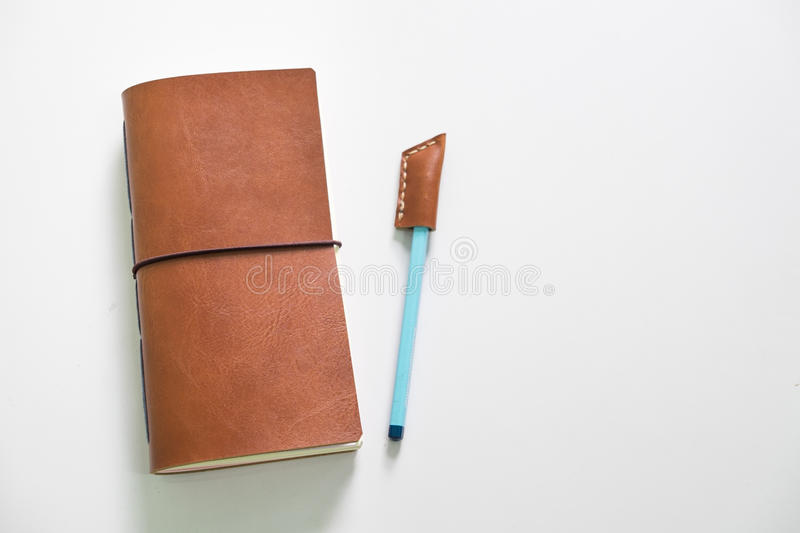 Leather notebook and crafting with pencil cover stock photography