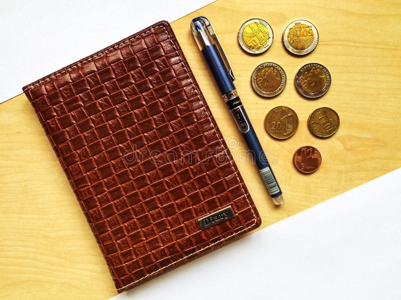 Leather notebook and pen. On table stock image