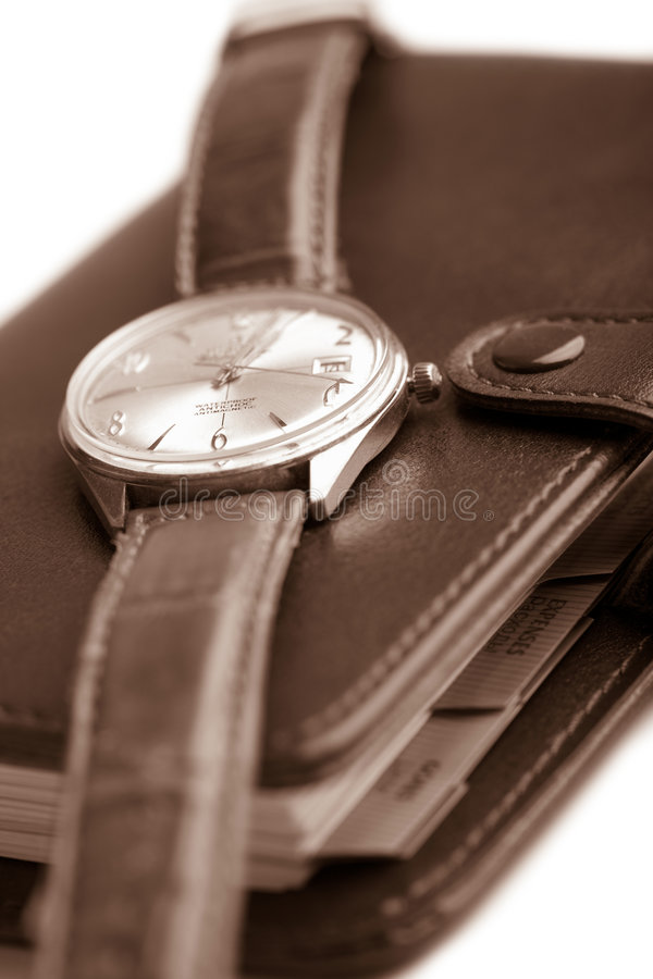 Leather organizer and watch isolated. (shallow DOF royalty free stock photo