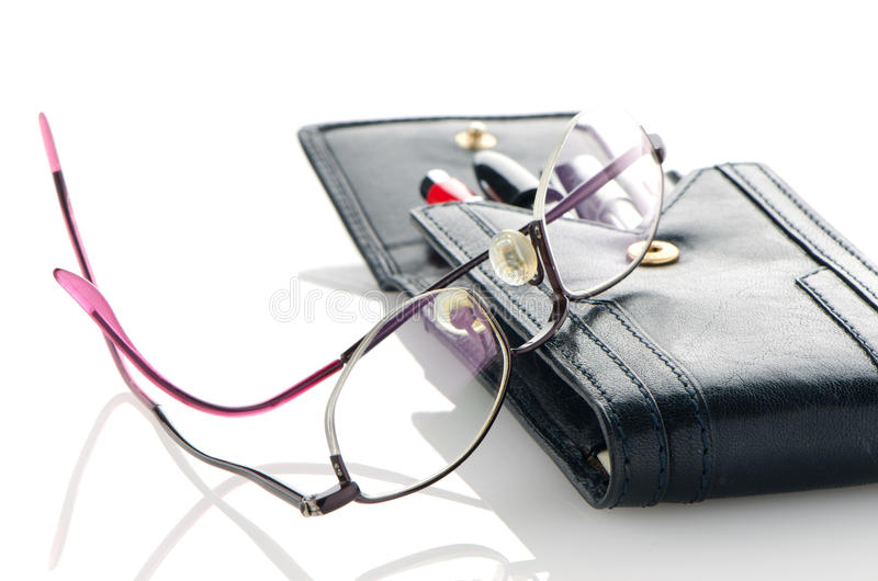 Leather pencil case and glasses. Leather notebook and glasses on white background royalty free stock photo