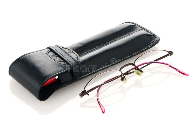 Leather pencil case and glasses. Leather notebook and glasses on white background stock photos