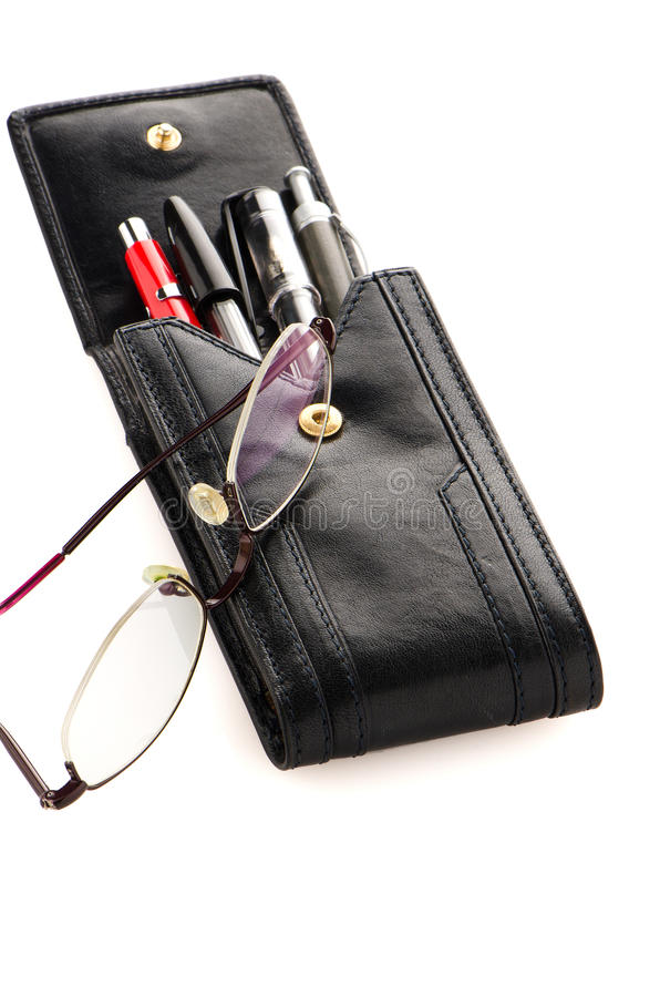 Leather pencil case and glasses. Leather notebook and glasses isolated on white background stock image