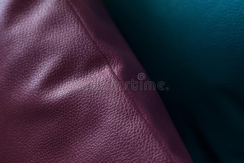 Leather of pillow. Leatherette of pillow decorated on sofa furniture, close up image royalty free stock images
