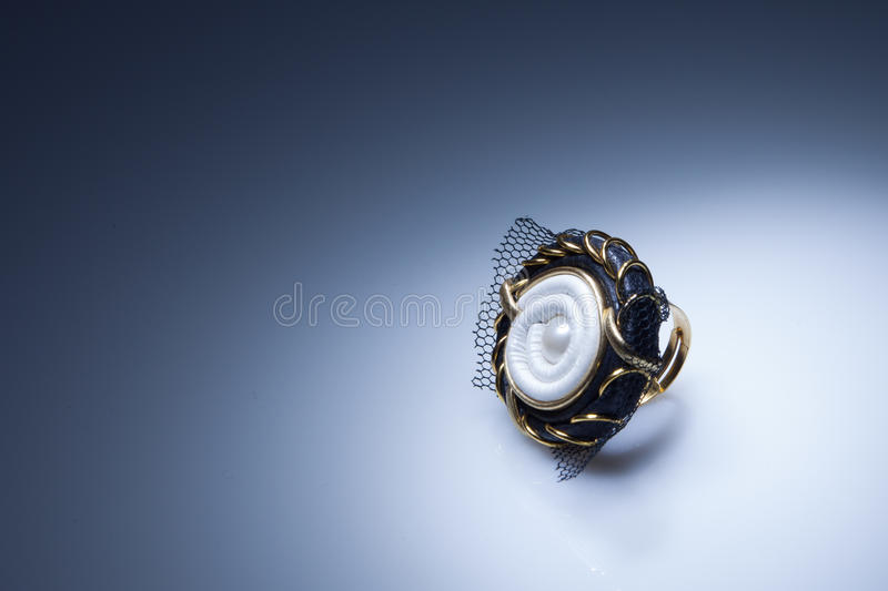 Leather ring with pearl and gold elements royalty free stock photo