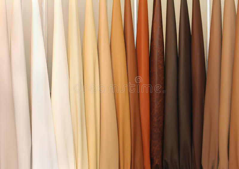 Leather samples. Leather color samples in neutral shades on furniture design studio wall stock images