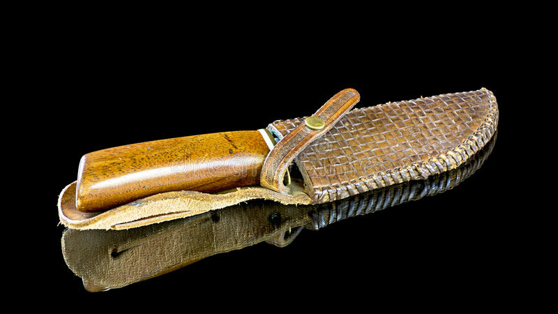 Leather sheath holds a hunting knife royalty free stock image