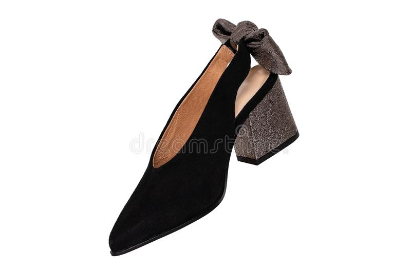 Leather shoes isolated. A elegant female suede shoe decorated with silver bow isolated on a white background. fashion 2019 royalty free stock image
