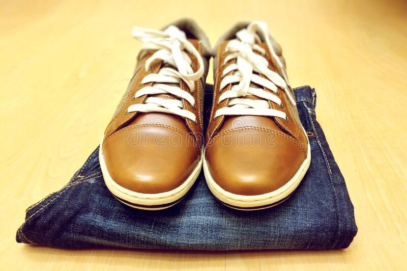 Leather shoes and jeans royalty free stock photo