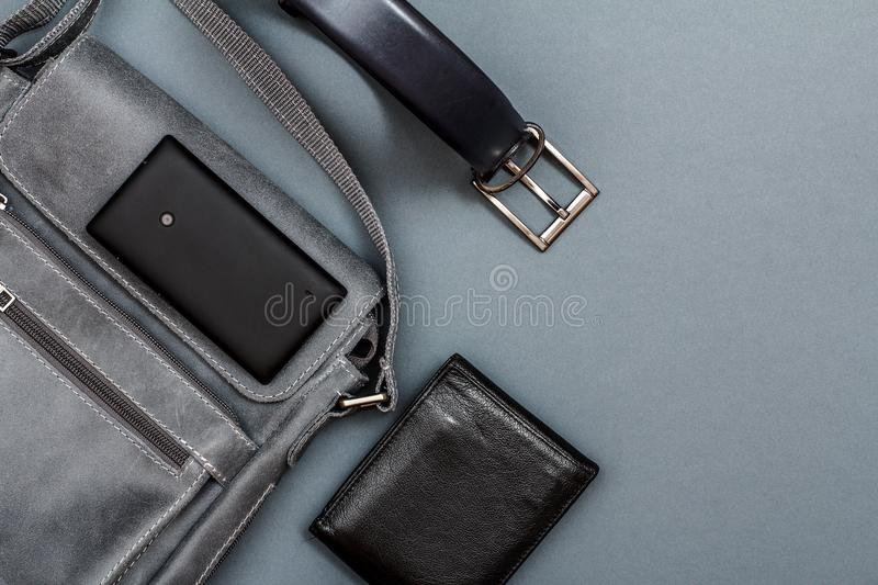 Leather shoulder bag for men with mobile phone on it, belt for m stock photo