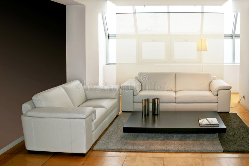 Leather sofas. Interior shot of living room with two leather sofas royalty free stock photo