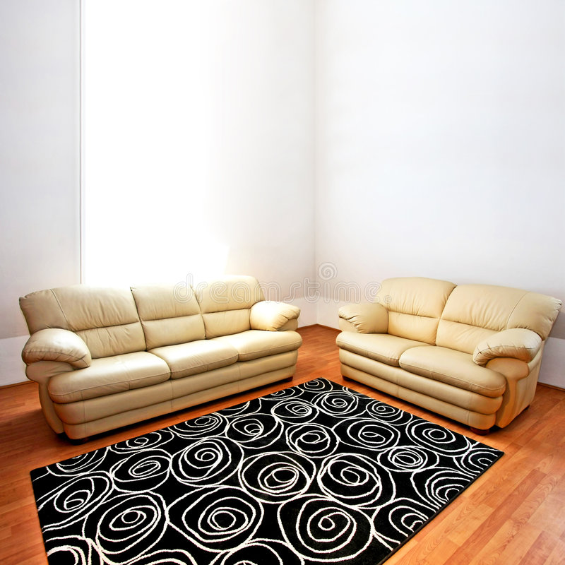 Leather sofas. Two beige leather sofas in living room royalty free stock photos