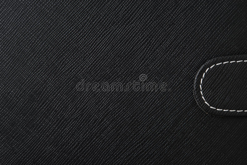 Leather texture. Black leather texture with white rope sew stock image