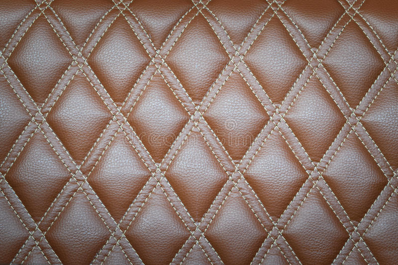 Leather texture. Leather diamond stripes brown color texture background natural color royalty free stock images