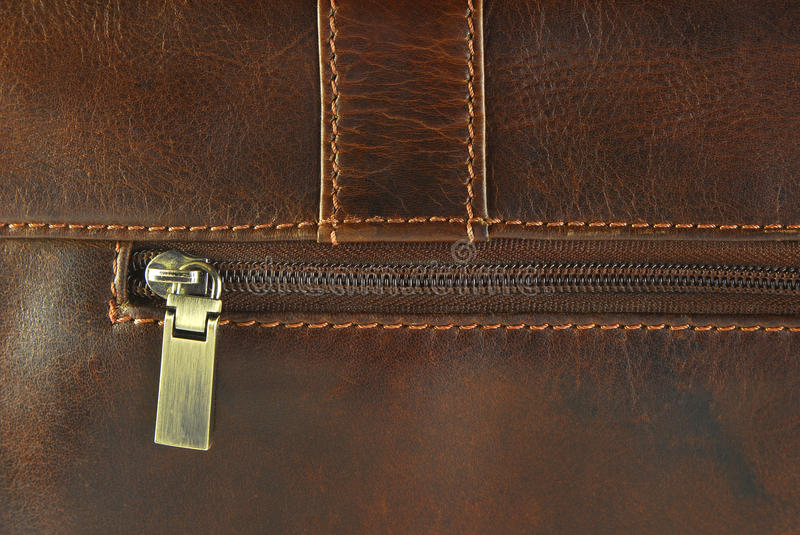 Leather texture with seam. Closeup of the worn leather with zipper texture stock image