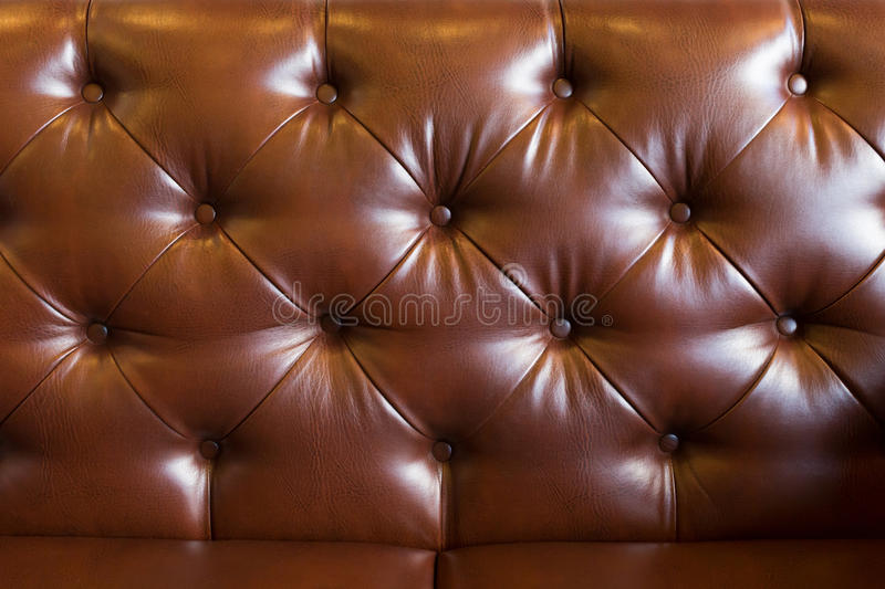 Leather upholstery brown sofa background stock images