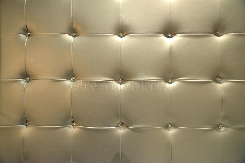 Leather upholstery. Golden leather upholstery texture background details stock images