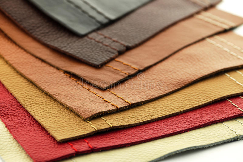 Leather upholstery samples. Natural leather upholstery samples with stitching in various colors stock photography