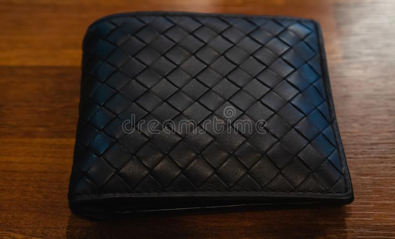 Leather wallet black leather on the wood background royalty free stock photography