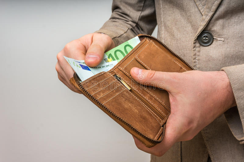 Leather wallet with euro money in male hands stock photos