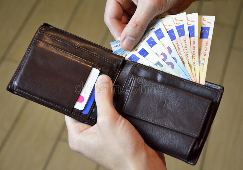 Leather wallet with money in male hands royalty free stock image