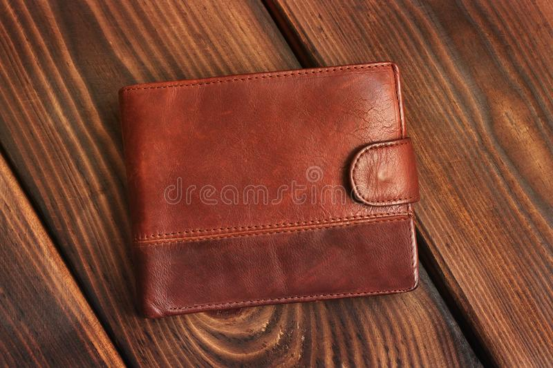 Leather wallet on a wooden background stock photo