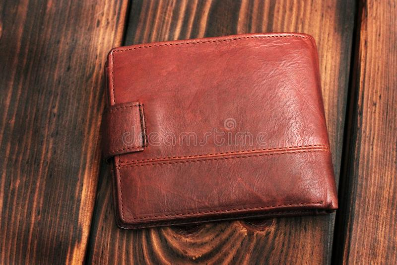 Leather wallet on a wooden background royalty free stock photo