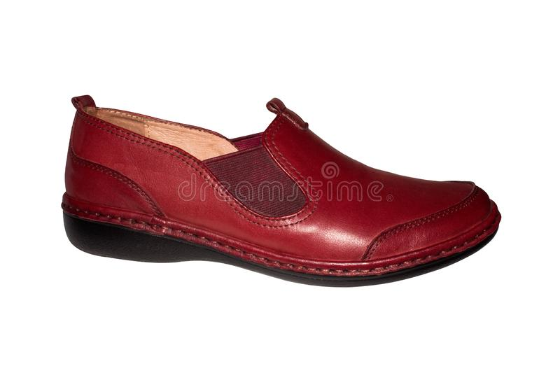 Leather women`s shoes red-brown. Leather women`s shoes red-brown on a white background stock photo