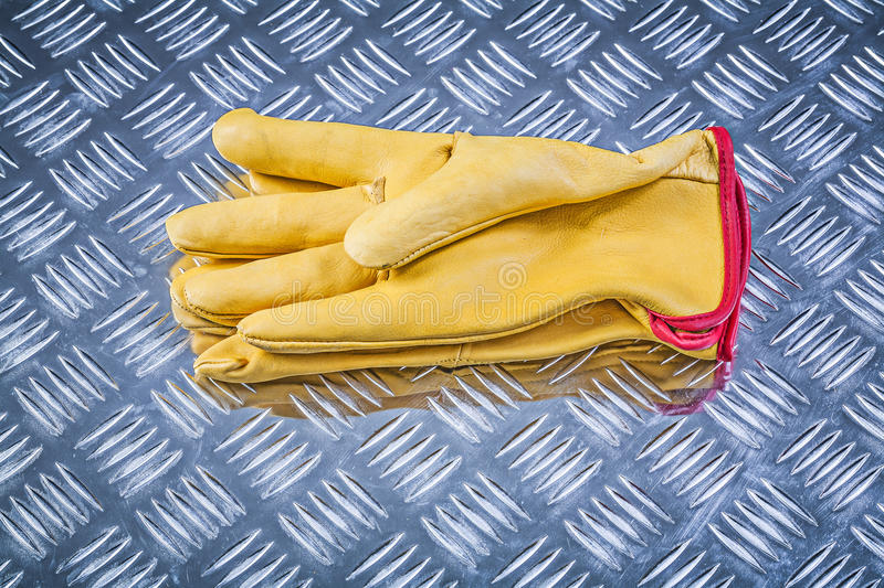 Leather working gloves on corrugated metal sheet construction co. Ncept stock photo