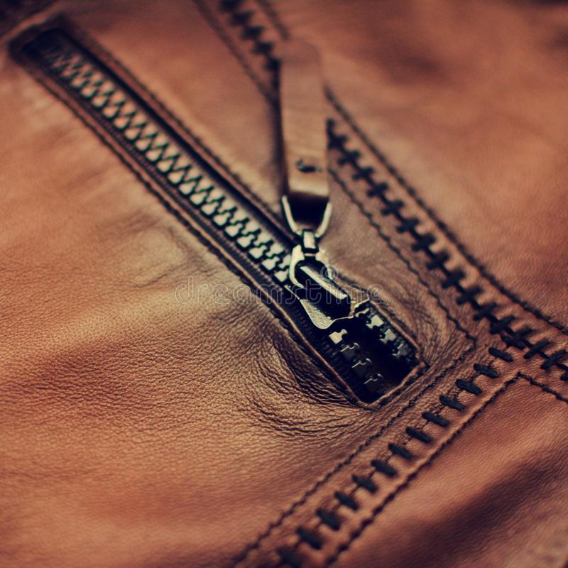 Leather zipper. Brown leather jacket zipper stock photo