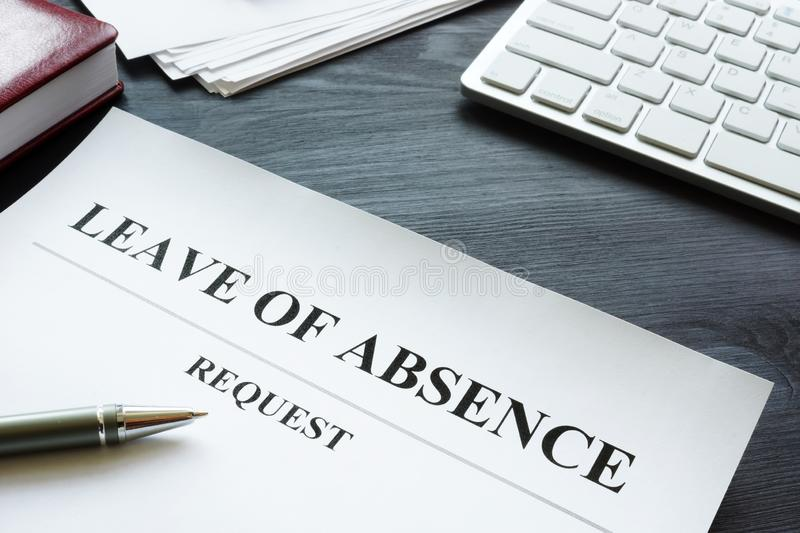 Leave of absence request on the table. Leave of absence request on the desk stock image