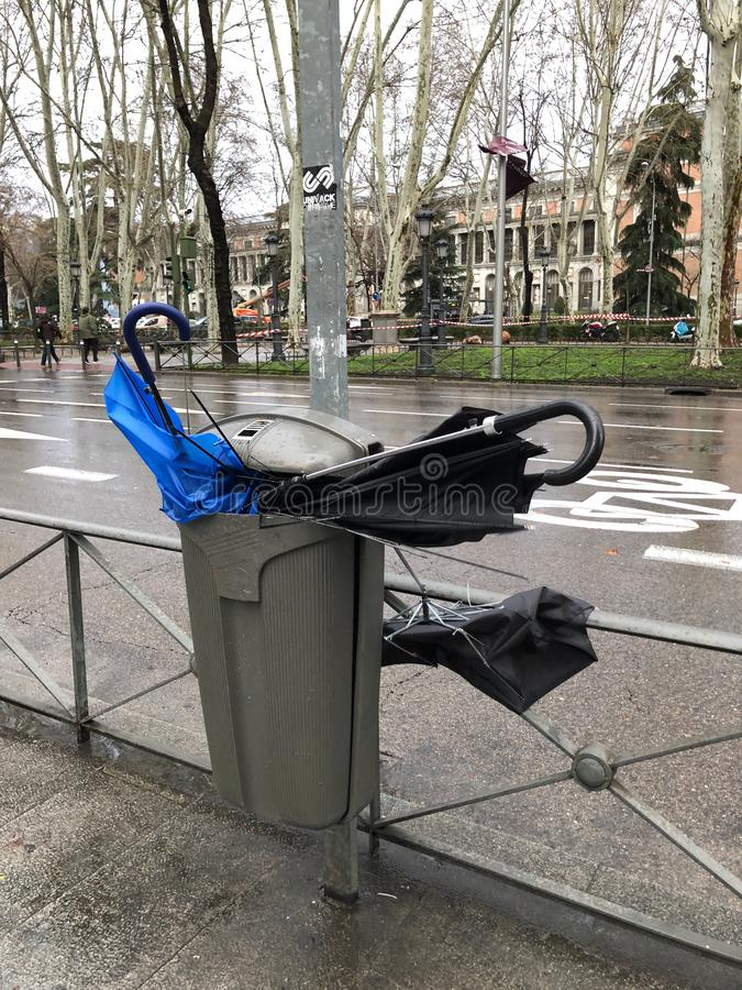 Leave me a place, broken umbrellas in a trash royalty free stock images