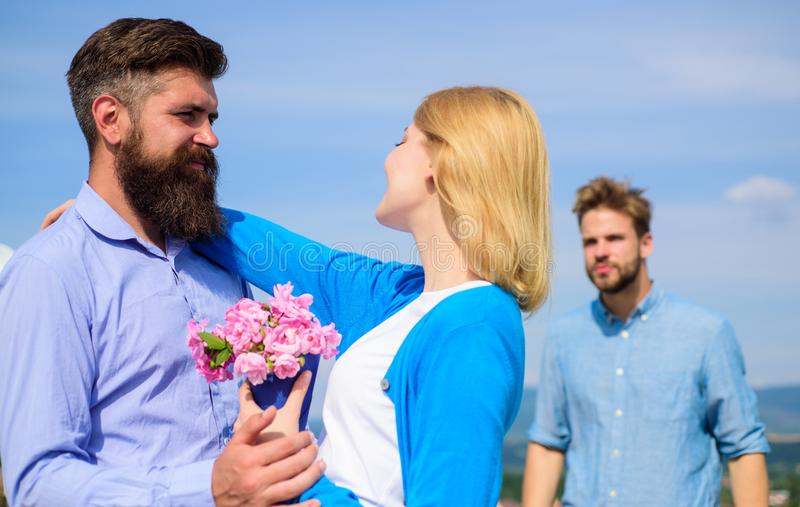 Leave past behind. Couple with bouquet romantic date. Ex husband jealous on background. Couple in love dating outdoor royalty free stock photo