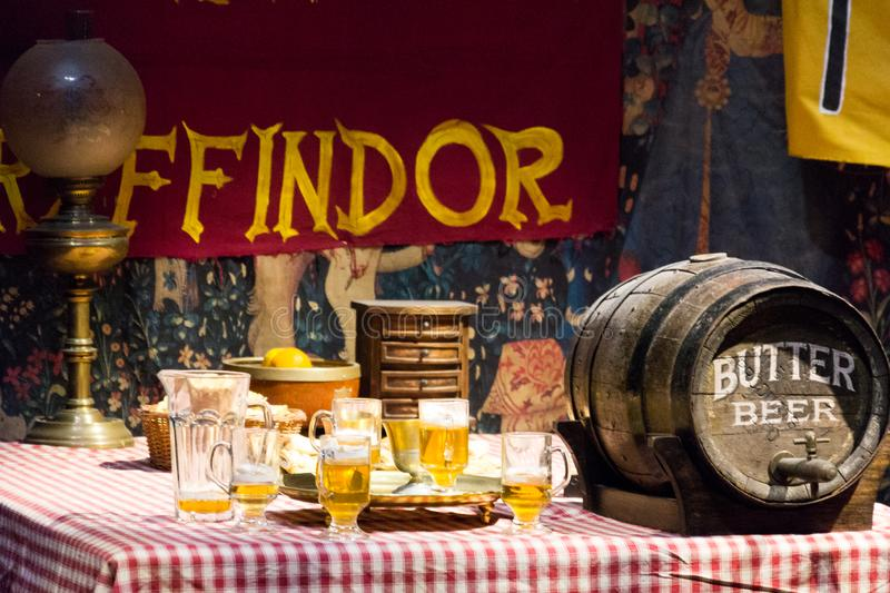 Gryffindor boys` dormitory, butter beer, the Making of Harry Potter Studio. Leaverden, England - August 31 2014: Gryffindor boys` dormitory, butter beer, the royalty free stock image