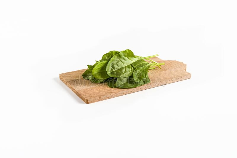 Leaves of green chard on cutting board  wood, on white background royalty free stock photography