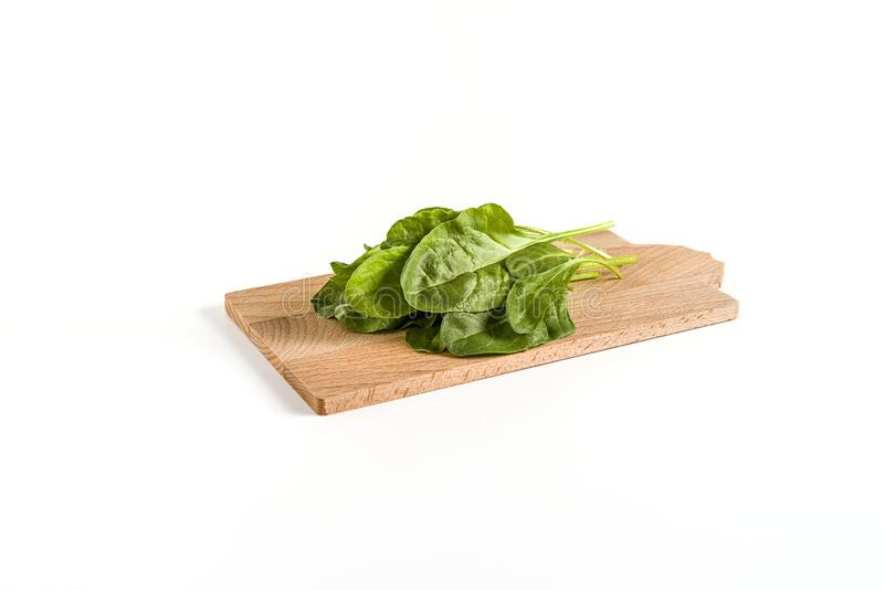 Leaves of green chard on cutting board  wood, on white background stock photography