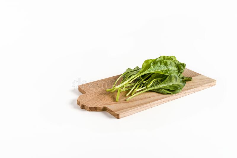 Leaves of green chard on cutting board  wood, on white background stock photos