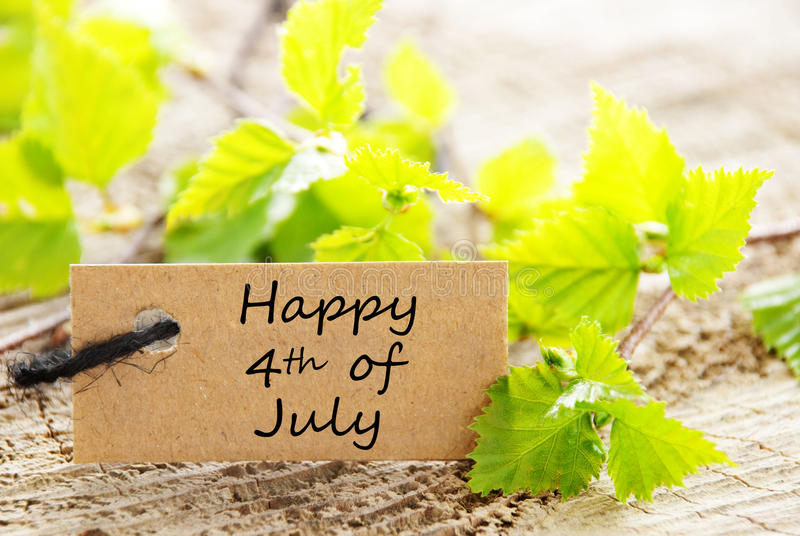 Leaves with Happy 4th of July. Label with Green Leaves and the Words Happy 4th of July stock image