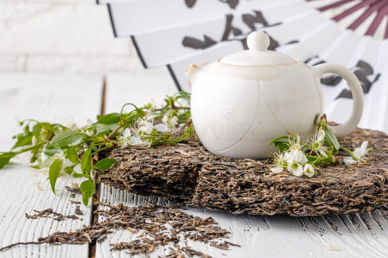 Leaves of puer tea in wooden tabnle stock photos