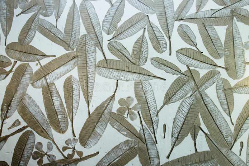 Leaves seamless pattern. Tropical leaves seamless pattern on painted background stock images