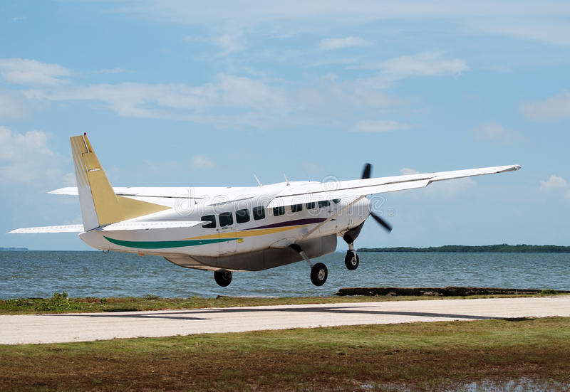 Leaving Belize. The small plane taking-off in Belize City airport (Belize stock photos