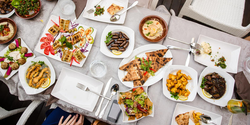 Lebanese food at the restaurant. Restaurant table with lebanese food stock photo