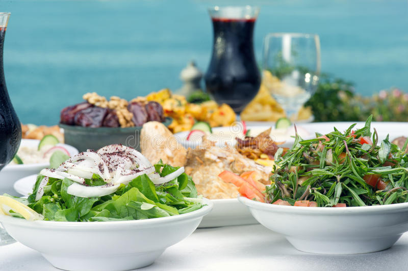 Lebanese food of rucola, thyme Salad, & Jalleb. Lebanese food presentation of rucola, thyme Salad, and Jalleb served in Ramadan royalty free stock photography