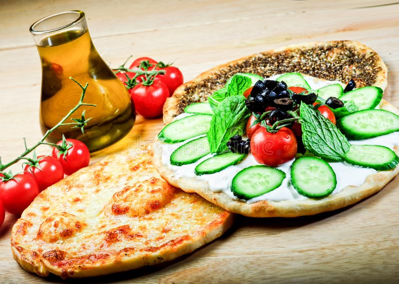 Lebanese food of thyme and manaqish stock photos