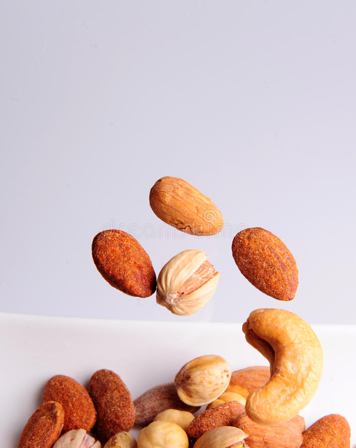 Lebanese nuts flying royalty free stock photos