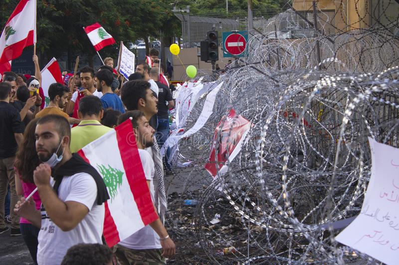 Lebanese protests. People with flags of Lebanon on a protest march. Peaceful protest escalated. Beirut, Lebanon - August 29, 2015: Lebanese protests. People with stock photo