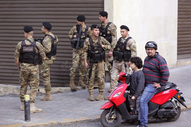 Lebanese soldiers patrol Beirut street. Beirut, Lebanon - 9 April, 2019: Armed Lebanese soldiers patrol a street of Beirut during daytime royalty free stock photography